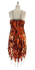 A short handmade sequin dress, in rectangular copper paillette sequins with silver faceted beads back view