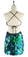 A short handmade sequin dress, in 30mm cut-out iridescent emerald green paillette sequins back view
