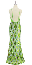 Long handmade sequin dress in flat metallic light green, hologram green and hologram silver sequins with faceted beads in a geometric pattern with a flared hemline back view