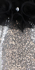 Short Silver Sequin Fabric Dress With Black Ruffles At Neckline Close View
