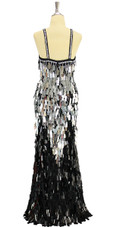 Long handmade sequin dress in rectangular black and metallic silver paillette sequins over black base fabric in a classic flared hemline cut back view