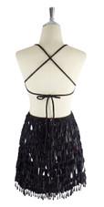 A short handmade sequin dress, with tear-drop shaped black paillette sequins back view