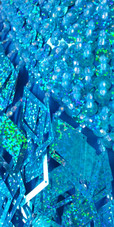 A short handmade sequin dress, with 10mm hologram turquoise fishscale sequins close up view