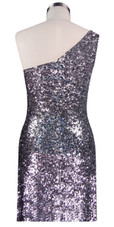Short patterned dress in metallic silver and red sequin spangles fabric in a one-shoulder cut back view