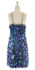 A short handmade sequin dress, in 20mm mixed metallic turquoise and metallic purple paillette sequins back view