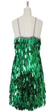 A short handmade sequin dress, in rectangular emerald green paillette sequins back view
