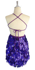 A short handmade sequin dress, with 10mm hologram dark lilac fishscale sequins overlaid with iridescent purple faceted beads back view