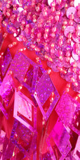 A short handmade sequin dress, with 10mm hologram fuchsia fishscale sequins close up view
