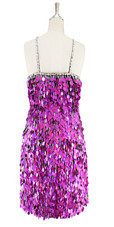 Short handmade sequin dress, in rectangular metallic fuchsia paillette sequins with silver faceted beads, a luxe grey fabric background and a straight hemline back view