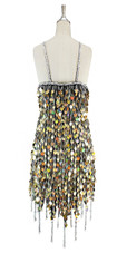 Short handmade sequin dress, in hologram gold paillette sequins with silver faceted beads, a luxe grey fabric background and jagged, beaded hemline back view