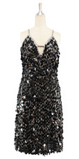 Short handmade sequin dress in black paillette sequins with silver faceted beads and a straight hemline front view.