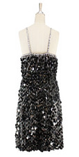 Short handmade sequin dress in black paillette sequins with silver faceted beads and a straight hemline back view