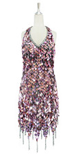Short handmade sequin dress, in metallic striated fuchsia paillette sequins with silver faceted beads, a luxe grey fabric background, halter-neck and a jagged, beaded hemline front view