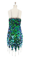 Short handmade sequin dress, in iridescent green paillette sequins with silver faceted beads, a luxe grey fabric background and jagged, beaded hemline back view