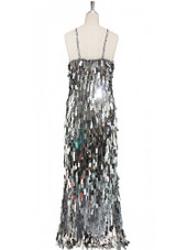 A long handmade sequin dress, in rectangular silver paillette sequins with silver faceted beads and a luxe grey fabric background in a classic cut back view