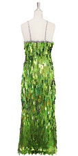 A long handmade sequin dress, in rectangular hologram olive green paillette sequins with silver faceted beads and a luxe grey fabric background in a classic cut back view