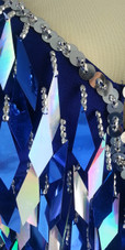 A short handmade sequin dress, in diamond-shaped metallic silver and dark blue sequins close up view