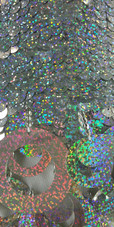 A short handmade sequin dress, with 10mm hologram silver fishscale sequins close up view