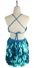 A short handmade sequin dress, in rectangular metallic turquoise color sequins back view