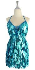 A short handmade sequin dress, in rectangular metallic turquoise color sequins front view