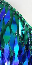 A short handmade sequin dress, in diamond-shaped iridescent green paillette sequins close up view