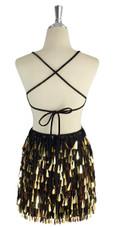 A short handmade sequin dress, with tear-drop shaped metallic gold paillette sequins back view