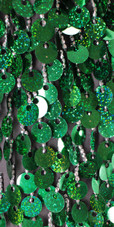A short handmade sequin dress, in metallic hologram emerald green paillette sequins with silver beads close up view