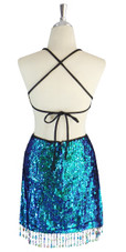 A short handmade sequin dress, in 8mm cupped iridescent green sequins back view