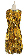 A short handmade sequin dress, in rectangular metallic gold paillette sequins with silver faceted beads back view