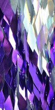 A long handmade sequin dress, in diamond shaped paillette sequins of purple and iridescent silver close view