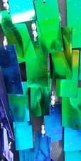 A long handmade sequin dress, in rectangular paillette metallic iridescent green sequins close view