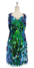 A short handmade sequin dress, in rectangular iridescent green paillette sequins with silver faceted beads front view