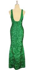 A long handmade sequin dress, in 8mm cupped metallic emerald green sequins back view