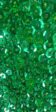A long handmade sequin dress, in 8mm cupped metallic emerald green sequins close up view