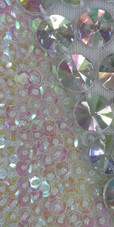 A long handmade sequin dress, in 8mm cupped iridescent transparent sequins close up view