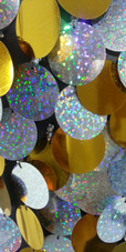 A long handmade sequin dress, in 30mm hologram silver  and gold mixed paillette sequins with silver faceted beads close up view