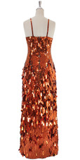 A long handmade sequin dress, in 10mm flat metallic sequins on the bodice and paillette rectangle sequins in copper back view
