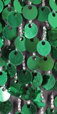 A long handmade sequin dress, in paillette emerald green sequins close up view