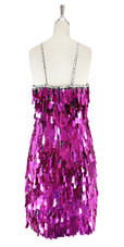 A short handmade sequin dress, in rectangular metallic fuchsia paillette sequins with silver faceted beads in back view