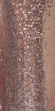 Long Dress In Gold Sequin Spangles Fabric With A Cowl Back In Close View