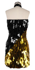 A short handmade sequin dress, in rectangular Black and gold paillette sequin dress in back view