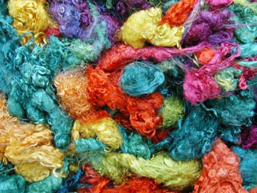 Throwsters waste silk fiber texture for feltmakers.  This dyed color is Confetti.