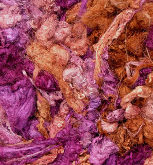 Throwsters waste silk fiber texture for feltmakers.  This dyed color is Patchouli.