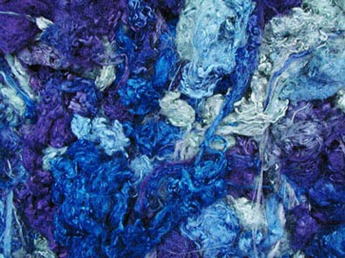 Throwsters waste silk fiber texture for feltmakers.  This dyed color is Rhythm 'n Blues