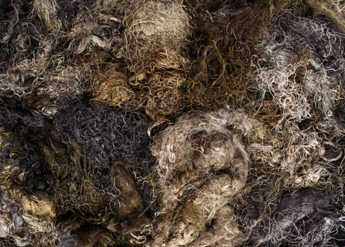 Throwsters waste silk fiber texture for feltmakers.  This dyed color is Ironbark