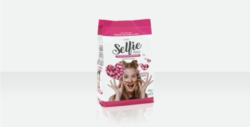 """SELFIE HARD WAX Delicate hard wax for face with Oils Complex.  Perfect for: – Eyebrows – Upper lip – Sideburns / Temporal area  Innovative """"Selfie"""" wax formulation was created specifically to remove unwanted hair on the sensitive face skin. Hard Wax """"Selfie"""" is formulated resin-free and is created to remove hair on the sensitive skin of the face. Natural oils complex in wax composition cushions wax effect on face, creates maximum protection and extra comfort during the procedure. Wax does not burn and does not injure delicate skin, it does not leave redness even on thin and sensitive skin. The working temperature of the hard wax is 100.4 °F.  Format: 1.1 lb.  Tips for various face areas waxing. Recommendations for better result:  EYEBROWS – For brow shaping, it is recommended to divide one long application into two short ones. – To create a sharp and clear line, use a small spatula. – Carefully press the spatula, it will help the wax to grip hairs better.  UPPER LIP – Tuck your upper lip under the teeth, it will make skin tauter. – Try to avoid the red lip area, it can lead to skin lifting. – Hold the spatula upright against the skin, it will lift the hairs and the wax grip will be stronger.  SIDEBURNS / TEMPORAL AREA – When working with long hair, it is recommended to apply wax in the direction of hair growth and remove against. – On large face areas you can use a standard spatula. – Before applying on already waxed area, make sure to use talcum powder."""