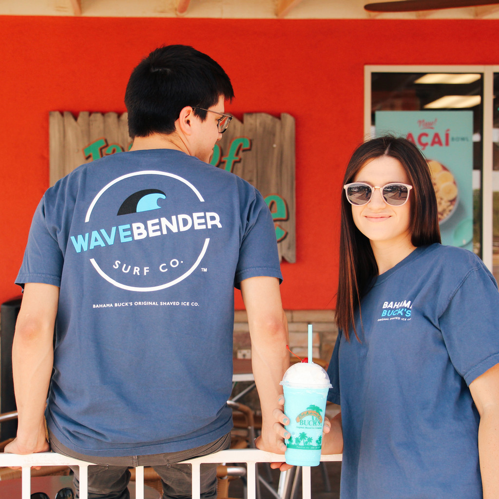 A guy sitting on shop railing next to a girl wearing the Wavebender shirt and holding a Wavebender smoothie
