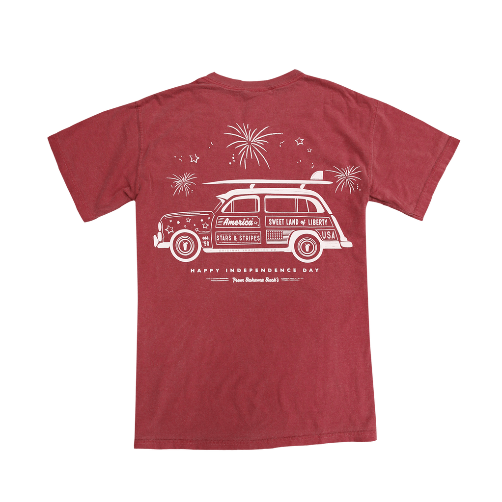 The back of the brick red, pocket Comfort Colors short-sleeve Independence Day Wagon tee with a white outline of an old school station wagon with a surf board on top. The text on the station wagon says America Stars and Stripes and Sweet Land of Liberty with Happy Independence Day from Bahama Buck's underneath the station wagon.