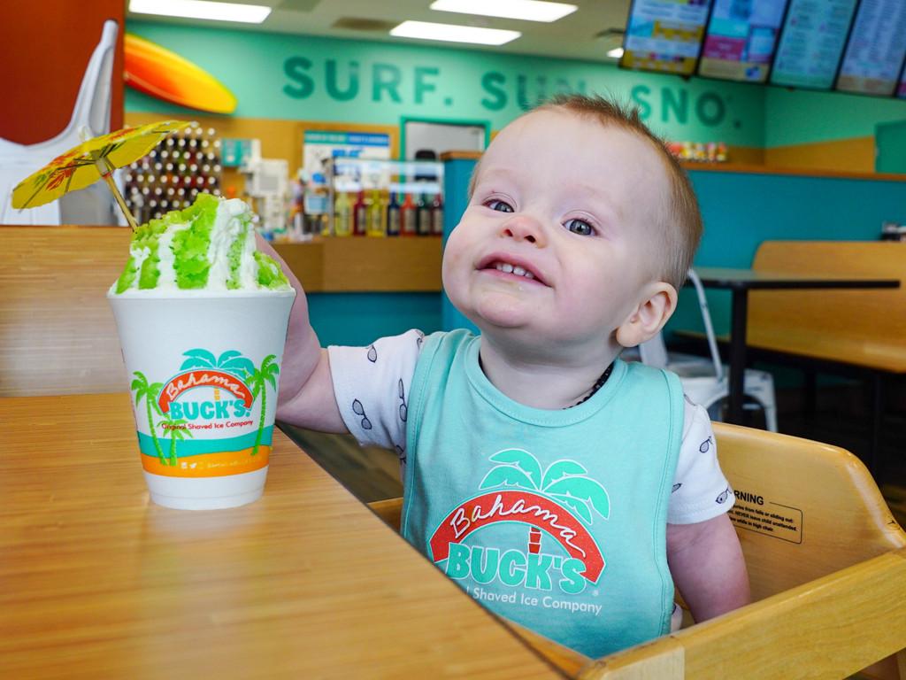 Bahama Buck's baby bib on toddler