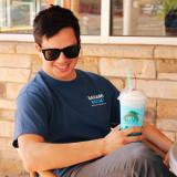 A young man enjoying a Wavebender smoothie in his Wavebender tee